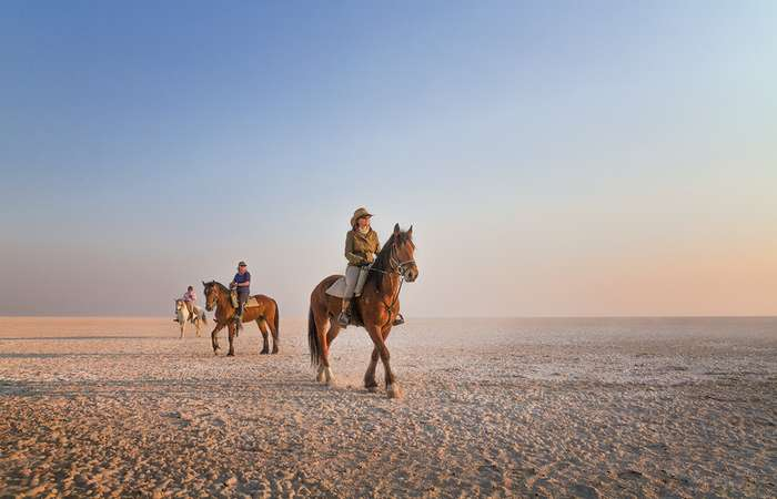 Horse riding on the Makgadikgadi Pans, Botswana