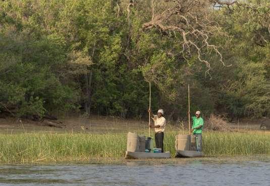 Transporting baggage by mokoro, Okavango Delta