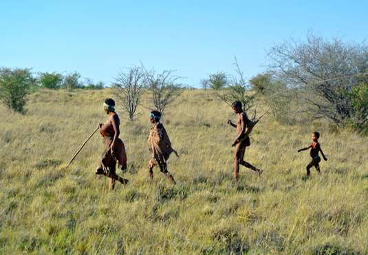 Bushmen family walking