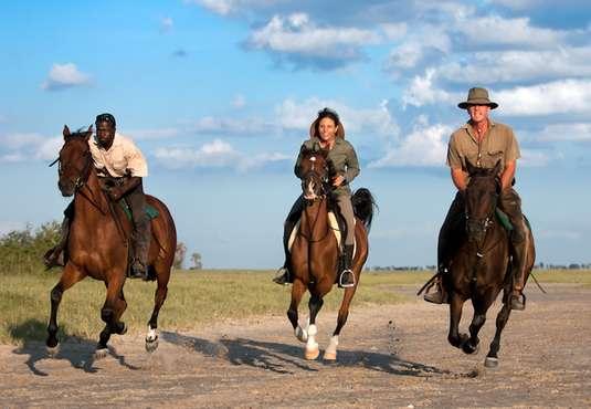 Horse riders galloping, Kalahari