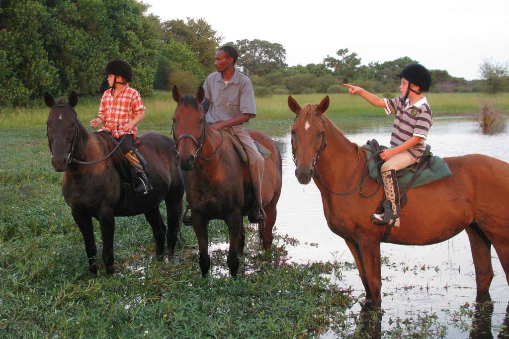 Children horse riding, Thamalakane River